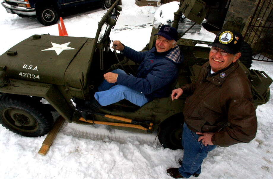 Gene Corsale, center, and Gene Raucci, both members of the Korean War Veterans Association, show off a World War II Willeys Jeep in 2004 at the New York State Military Museum and Veterans Research Center in Saratoga Springs, N.Y. The family of Raucci's brother-in-law, Frank Sabatino, donated the Jeep to the museum. (Cindy Schultz/Times Union archive) Photo: CINDY SCHULTZ / ALBANY TIMES UNION