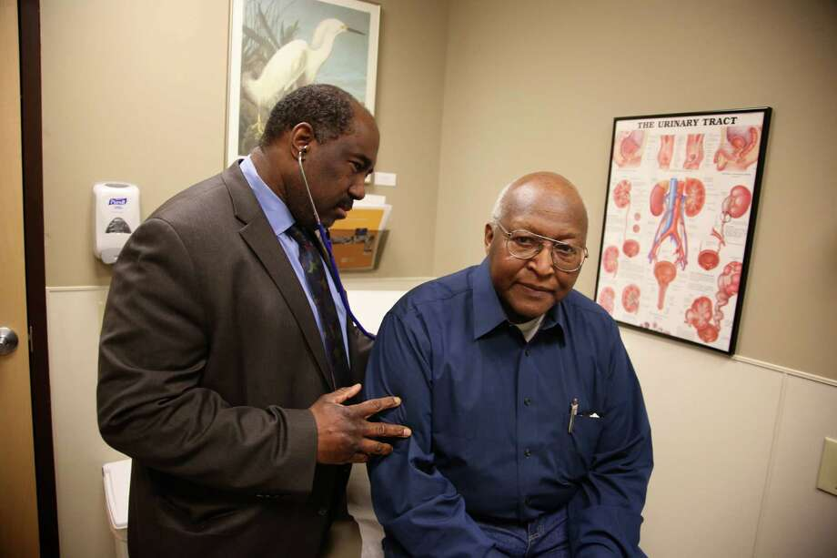 This photo taken Feb. 24, 2014, provided by the Roswell Park Cancer Institute, shows Dr. Willie Underwood, a urologic oncologist at Roswell Park Cancer Institute, examining patient Richard Waldrop at the Roswell Park Cancer Institute, in Buffalo, N.Y. Cancer patients relieved that they can get insurance coverage because of the new health care law may be disappointed to learn that some of the nation's best cancer hospitals are off limits. Only four of 19 nationally recognized comprehensive cancer centers that responded to an Associated Press survey said patients have access through all the insurance companies in their state's exchange, or primary market. (AP Photo/Roswell Park Cancer Institute, Bill Sheff)  ORG XMIT: WX103 Photo: Bill Sheff / Roswell Park Cancer Institute