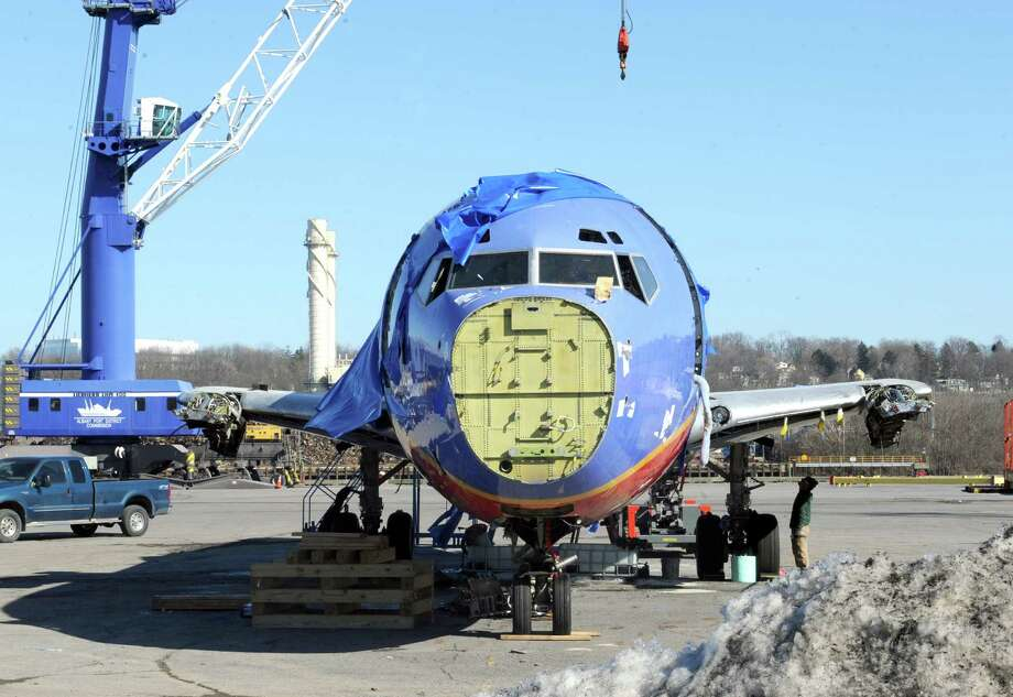 A former SouthWest Airlines jet is disassemble at the Port of Albany on Tuesday March 18, 2014 in Albany, N.Y. (Michael P. Farrell/Times Union) Photo: Michael P. Farrell / 00026198A