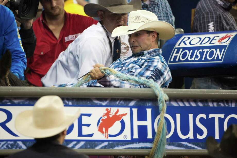 Jesse Kruse prepares to compete on the BP Super Series V Champion Round Saddle Bronc Riding at Reliant Stadium, Tuesday March 18, 2014, in Houston. Photo: Marie D. De Jesus, Houston Chronicle / © 2014 Houston Chronicle