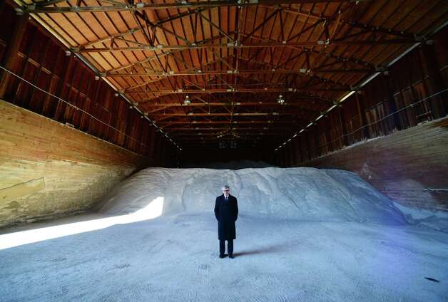 Town of Colonie Commissioner of Public Works John Cunningham stands next to the town's salt supply Tuesday morning, March 18, 2014, at the town garage on Old Niskayuna Road in Colonie, N.Y. (Will Waldron/Times Union) Photo: WW