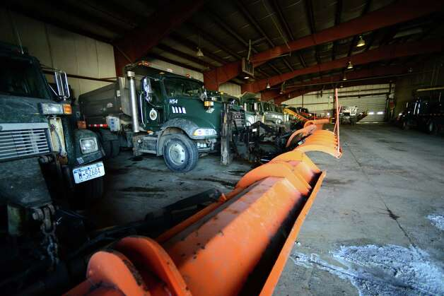 Snowplows are parked at the Town of Colonie Department of Public Works facilities Tuesday morning, March 18, 2014, on Old Niskayuna Road in Colonie, N.Y. (Will Waldron/Times Union) Photo: WW