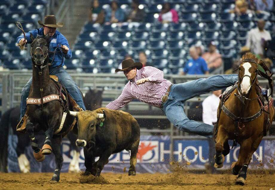 Sean Santucci competes in the BP Super Series V Champion Round Steer Wrestling competition during Houston Livestock Show and Rodeo at Reliant Stadium on Tuesday, March 18, 2014, in Houston. Photo: Marie D. De Jesus, Houston Chronicle / © 2014 Houston Chronicle