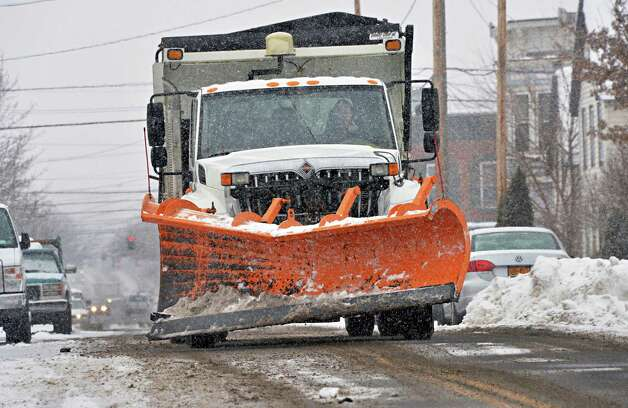 A Troy city snow plow on 112th Street Tuesday, Feb. 18, 2014, in Troy, NY.  (John Carl D'Annibale / Times Union archive) Photo: John Carl D'Annibale / 00025810A