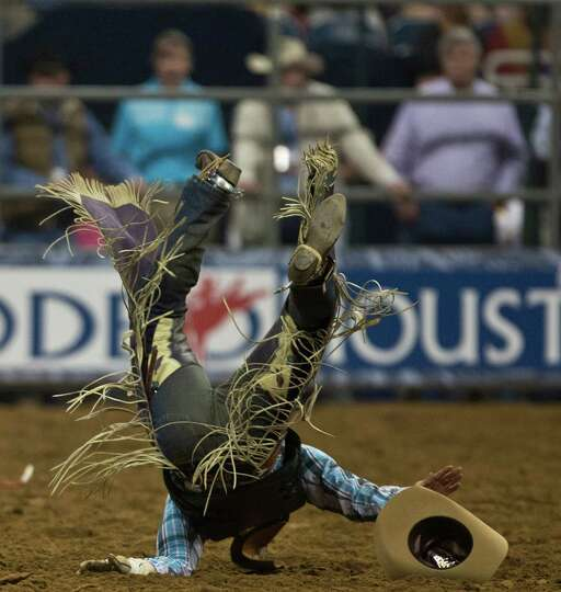 Brennon Eldred gets thrown off of the bull during the BP Super Series V Champion Round Bull Riding c
