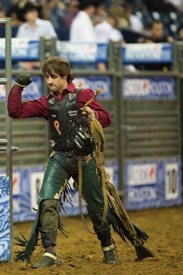 Sage Kimzey reacts after getting a high scoring during the BP Super Series V Champion Round Bull Riding competition during Houston Livestock Show and Rodeo at Reliant Stadium on Tuesday, March 18, 2014, in Houston. Photo: Marie D. De Jesus, Houston Chronicle / © 2014 Houston Chronicle