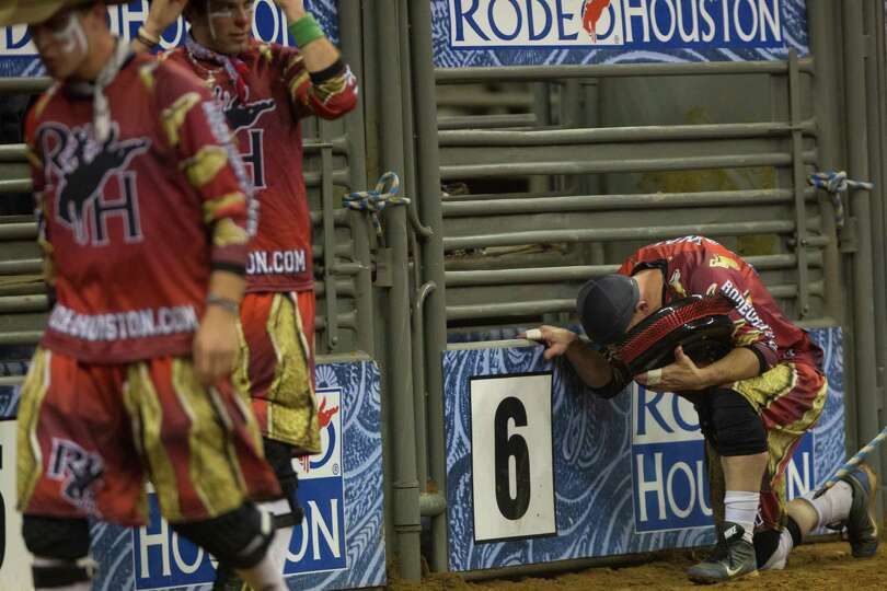Bullfighter Cory Wall takes a moment for a prayer after the bull riding competition during the BP Su