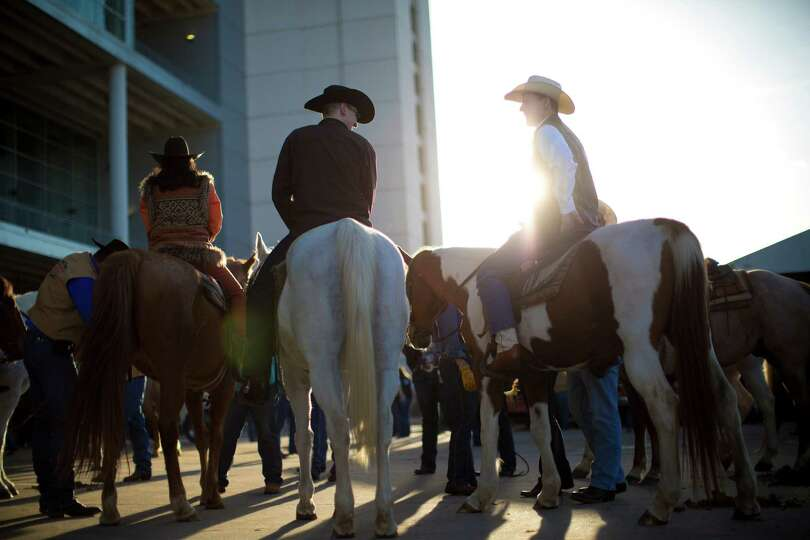 The RodeoHouston Grand Entry participants make way into the Reliant Stadium, Tuesday, March 18, 2014