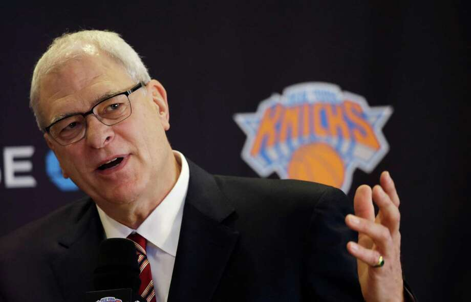 Phil Jackson, the new president of the New York Knicks, answers questions during a news conference, Tuesday, March 18, 2014 in New York. Jackson, who won two NBA titles as a player with the Knicks, also won 11 championships while coaching the Chicago Bulls and the Los Angeles Lakers. (AP Photo/Mark Lennihan) ORG XMIT: NYML104 Photo: Mark Lennihan / AP