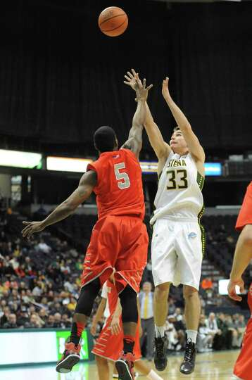 Siena's Rob Poole shoots a three during their first round College Basketball Invitational game again