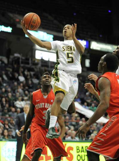 Siena's Evan Hymes goes to the basket during their first round College Basketball Invitational game