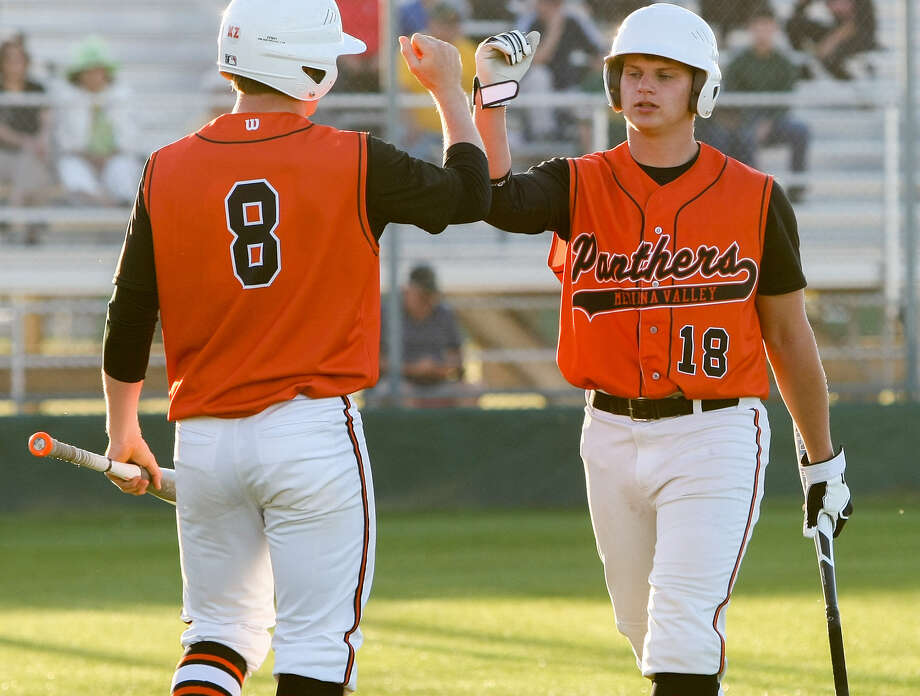 Medina Valley's Corey Modgling (right) is congratulated by teammate Kyle Moos as he returns to the dugout after scoring a run during the Panthers' 7-1 victory over McCollum on Tuesday. Photo: Marvin Pfeiffer / San Antonio Express-News / Express-News 2014