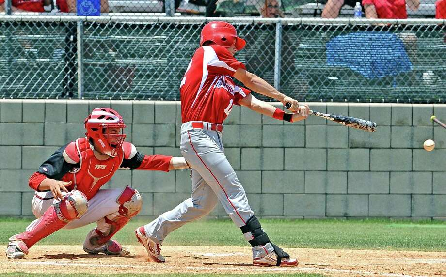 Bridge City player Chase Shugart, #12, hits a single to shortstop during the Bridge City playoff baseball game against Huffman-Hargrave on Saturday, May18, 2013, in La Porte. Photo taken: Randy Edwards/The Enterprise Photo: Randy Edwards