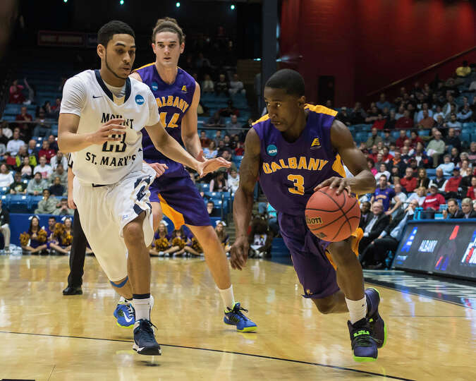 UAlbany Great Danes guard DJ Evans (3) drives the ball against Mount St Mary's  Mountaineers guard J