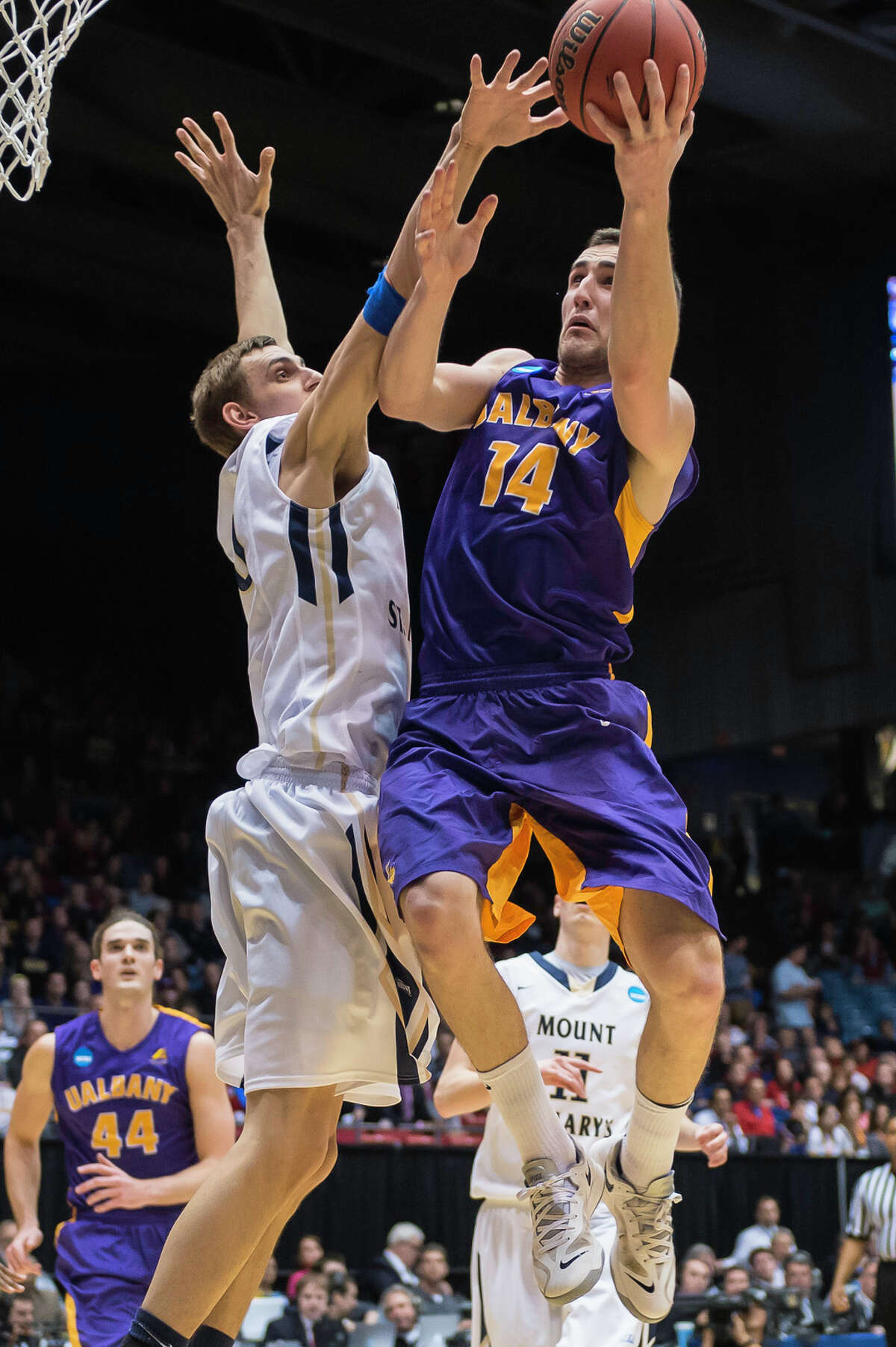 UAlbany Great Danes forward Sam Rowley (14) right puts up a shot from the paint with Mount St Mary's Mountaineers center Taylor Danaher (50) left defending during the NCAA first round game, Tuesday night, Mar. 18, 2014, in Dayton, O.H. (Gregory Fisher/Special to the Times Union)