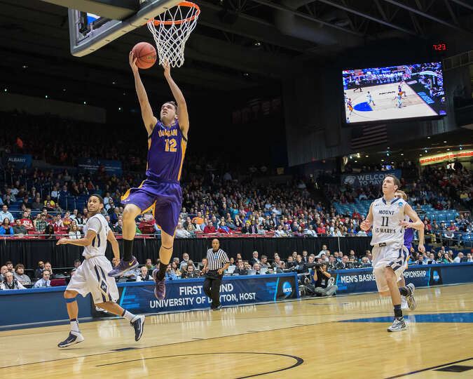 UAlbany Great Danes guard Peter Hooley (12) gets the layup on the fast break during the NCAA first r