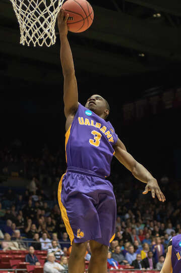 UAlbany Great Danes guard DJ Evans (3) puts up the layup on the fast break during the first half of