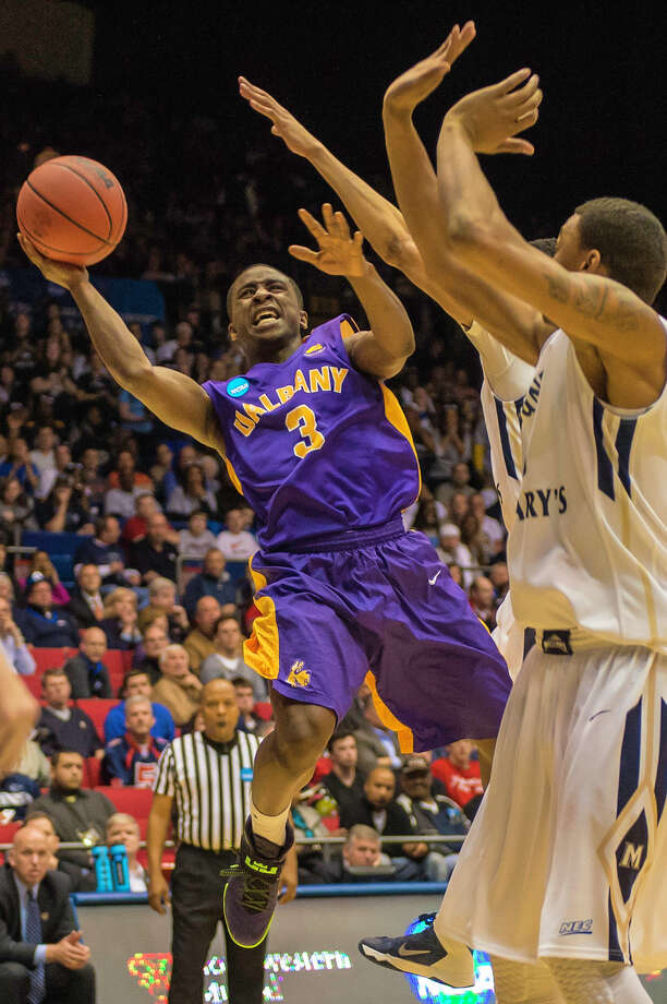 UAlbany Great Danes guard DJ Evans (3) puts up a shot against Mount St. Marys Mountaineers during the NCAA first round game, Tuesday night, Mar. 18, 2014, in Dayton, O.H. (Gregory Fisher/Special to the Times Union) Photo: GF / 00025174A