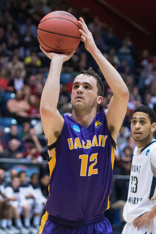 UAlbany Great Danes guard Peter Hooley (12) hits his free throw with seconds left to extend their lead in the NCAA first round game against Mount St. Marys, Tuesday night, Mar. 18, 2014, in Dayton, O.H. (Gregory Fisher/Special to the Times Union) Photo: GF / 00025174A