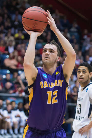 UAlbany Great Danes guard Peter Hooley (12) hits his free throw with seconds left to extend their le