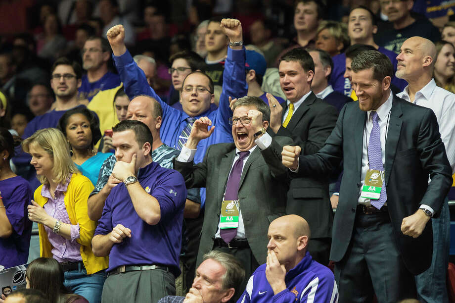 UAlbany fans celebrate the win over Mount St. Marys in the NCAA first round game, Tuesday night, Mar. 18, 2014, in Dayton, O.H. UAlbany won 71-64 over Mount St. Marys. (Gregory Fisher/Special to the Times Union) Photo: GF / 00025174A