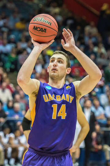 UAlbany Great Danes forward Sam Rowley (14) shoots a free throw to help clinch the win with seconds