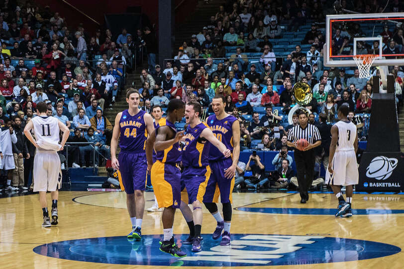 UAlbany Great Danes guard DJ Evans (3) and UAlbany Great Danes guard Peter Hooley (12) chest bump af