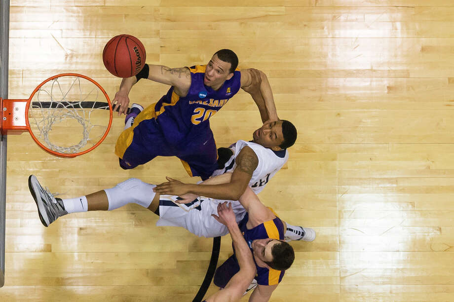 UAlbany Great Danes forward Gary Johnson (20) puts up the shot against Mount St. Marys during the NCAA first round game, Tuesday night, Mar. 18, 2014, in Dayton, O.H. (Gregory Fisher/Special to the Times Union) Photo: GF / 00025174A