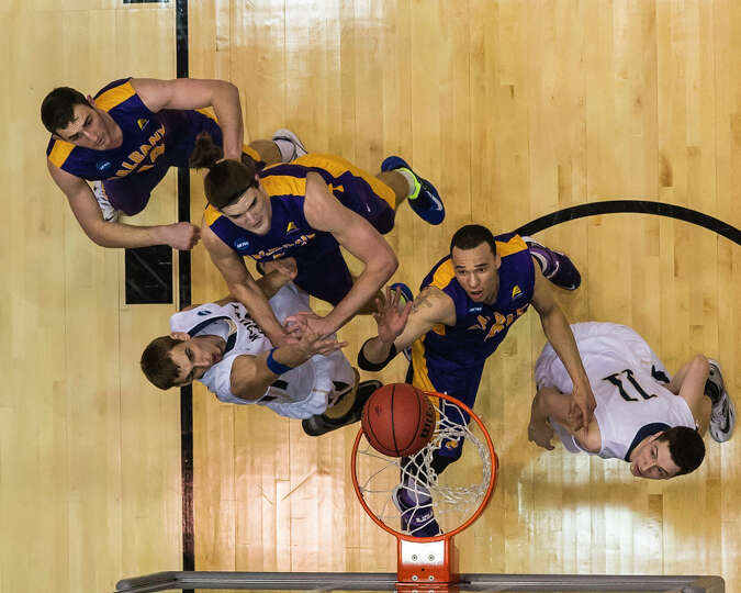 UAlbany Great Danes forward Gary Johnson (20) gets the score with Mount St Mary's  Mountaineers forw