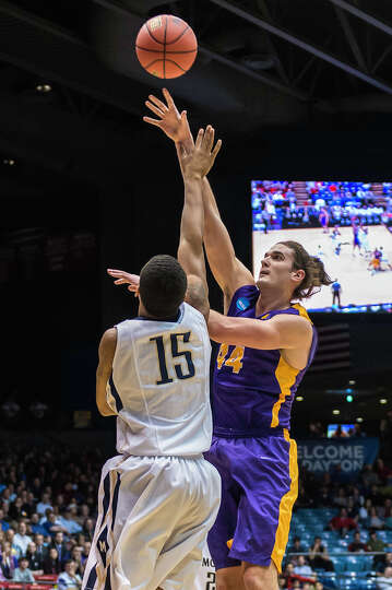 UAlbany Great Danes center John Puk (44) puts up a hook shot over Mount St Mary's  Mountaineers forw