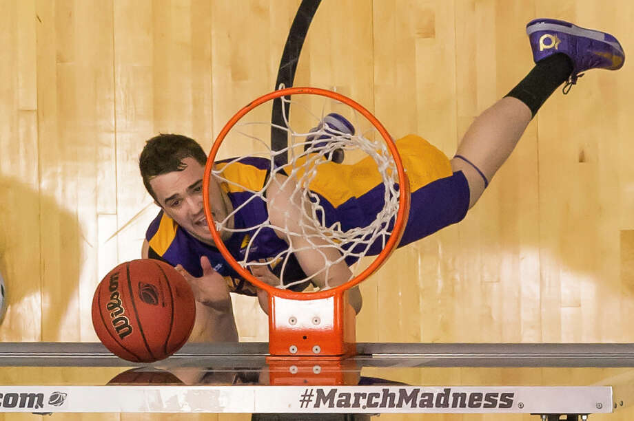 UAlbany Great Danes guard Peter Hooley (12) gets the layup against Mount St. Marys during the second half of the NCAA first round game, Tuesday night, Mar. 18, 2014, in Dayton, O.H. (Gregory Fisher/Special to the Times Union) Photo: GF / 00025174A