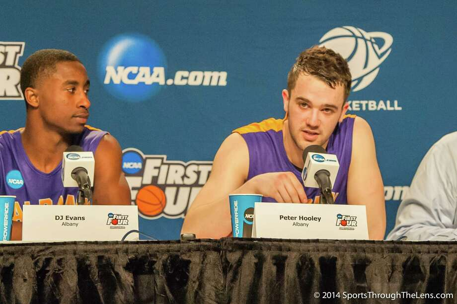 UAlbany Great Danes guard Peter Hooley (12), right, responds to a question during the post game interview along with UAlbany Great Danes guard DJ Evans (3) after the NCAA first round game against Mount St. Marys, Tuesday night, Mar. 18, 2014, in Dayton, O.H. (Gregory Fisher/Special to the Times Union) Photo: GF / 00025174A