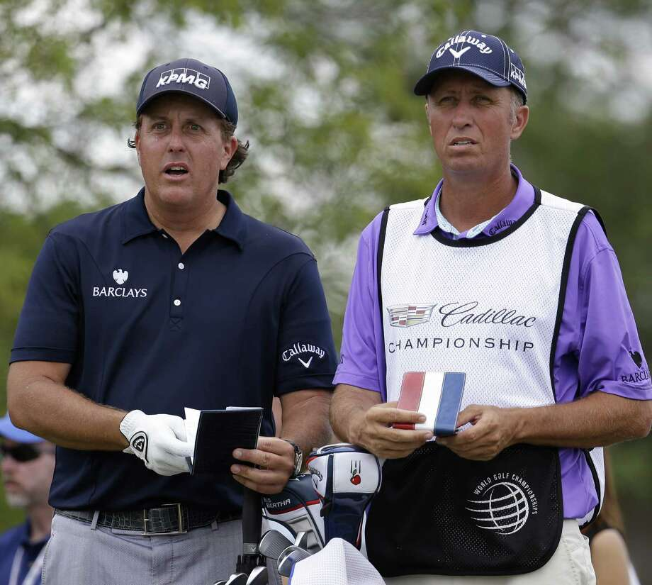 Phil Mickelson (left), with caddie Jim Mackay, hasn't played the Texas Open since 1992, but his return would give the local tournament instant added star power. Photo: Lynne Sladky / Associated Press / AP