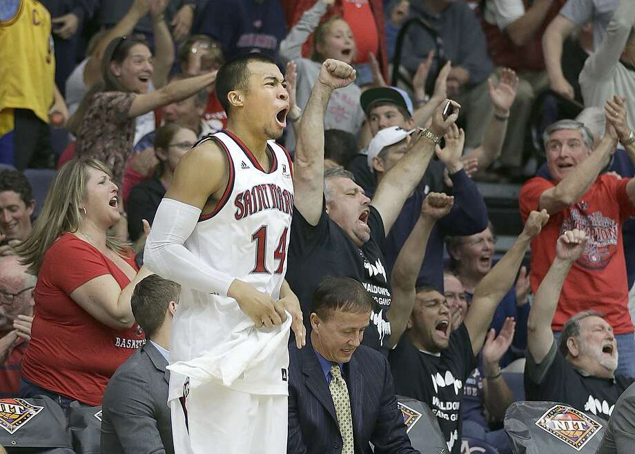 St. Mary's senior point guard Stephen Holt, who had 15 points, celebrates the Gaels' win. Photo: Tony Avelar, Associated Press