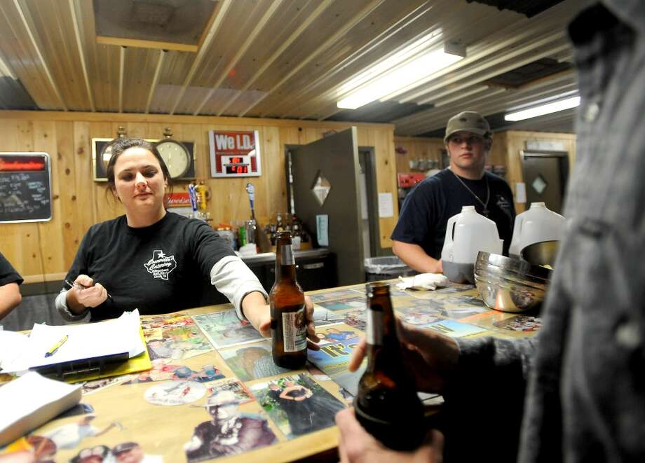 Paula Breaux serves a big from the bar at Big Rich Courville's in Beaumont, Thursday, December 1, 2011. Tammy McKinley/The Enterprise
