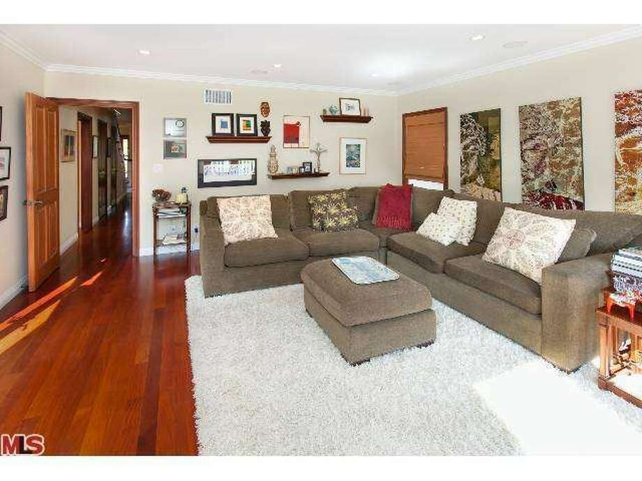 There are hardwood floors throughout many of the rooms. Photo: Photo By MLS