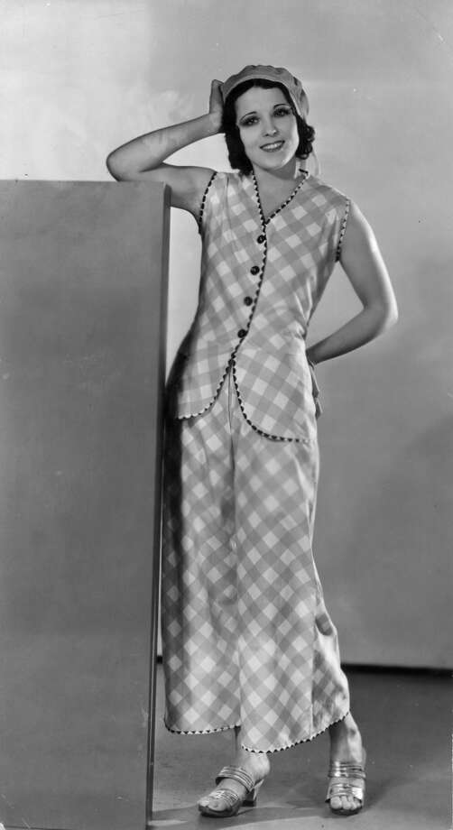 A woman wears gingham pajama trousers with matching tunic, circa 1926. Photo: General Photographic Agency, Getty Images