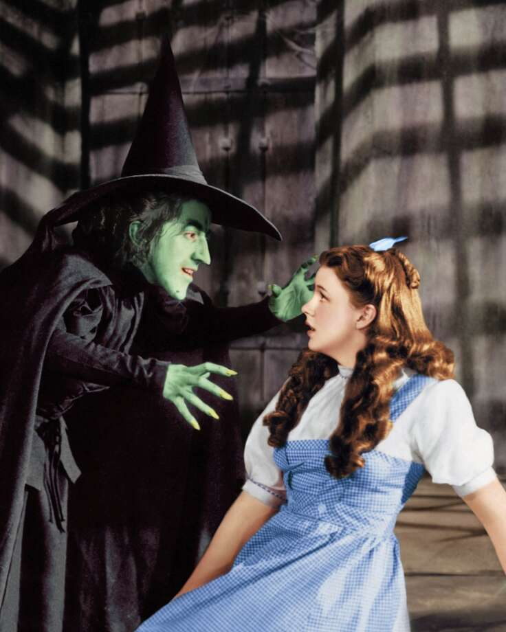 "Margaret Hamilton (1902 - 1985) as the Wicked Witch and Judy Garland (1922 - 1969) as Dorothy Gale in ""The Wizard of Oz,"" 1939, wearing her iconic gingham ensemble. Photo: Silver Screen Collection, Getty Images"