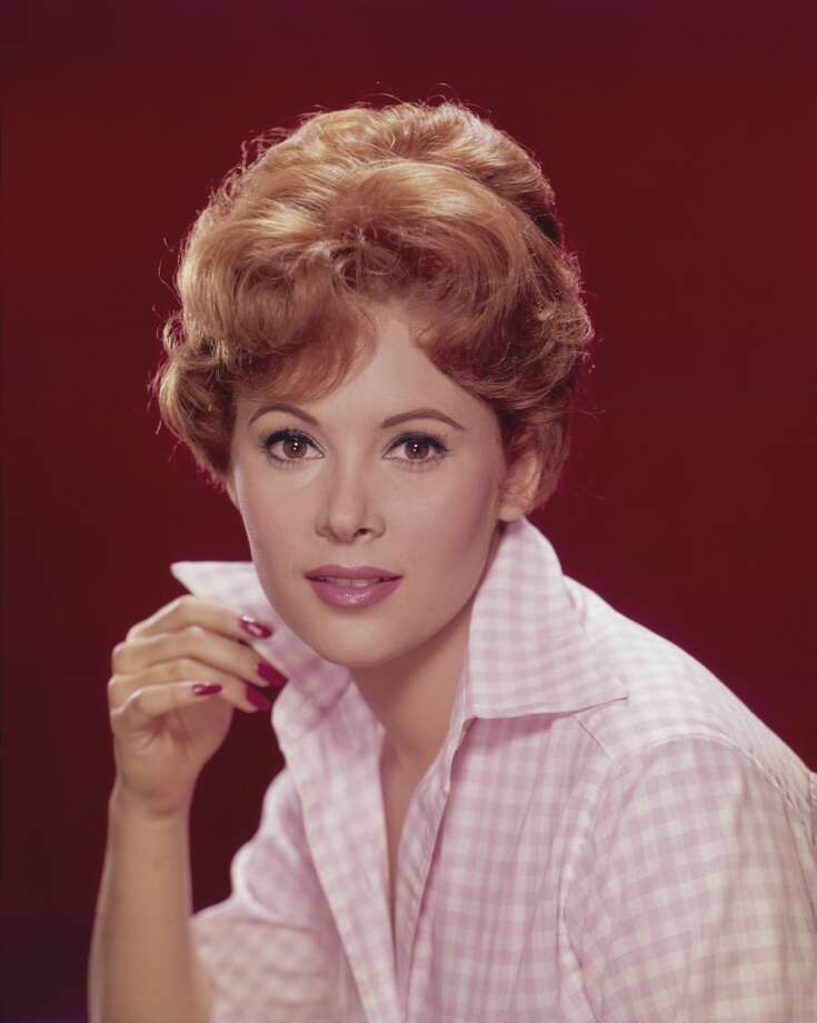 Actress Jill St. John pictured with her right hand holding the collar of her pink gingham shirt, circa 1960. Photo: Archive Photos, Getty Images
