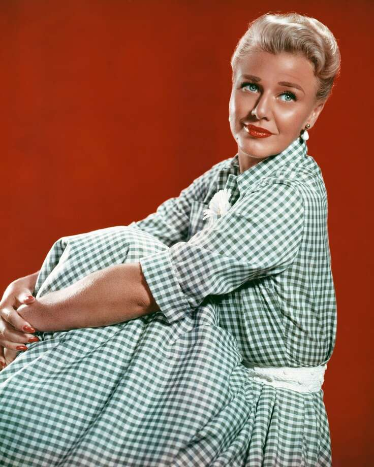 American actress and dancer Ginger Rogers (1911 - 1995) in a blue gingham dress, circa 1950. Photo: Silver Screen Collection, Getty Images