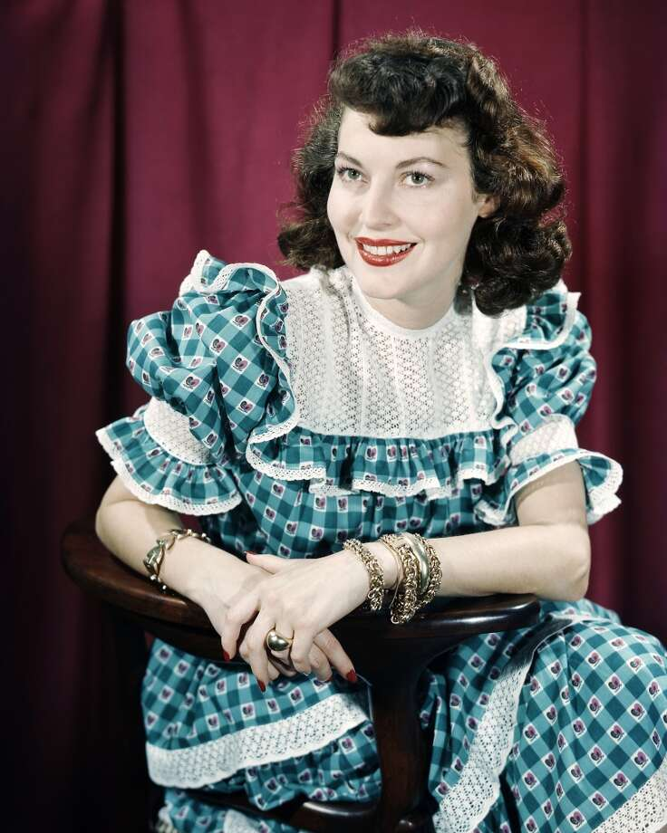 Ava Gardner (1922-1990) smiling and  wearing a blue gingham dress in a studio portrait, circa 1955. Photo: Silver Screen Collection, Getty Images