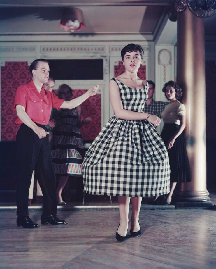 A young woman dancing in a gingham dress, 1957. Photo: Paul Popper/Popperfoto, Popperfoto/Getty Images