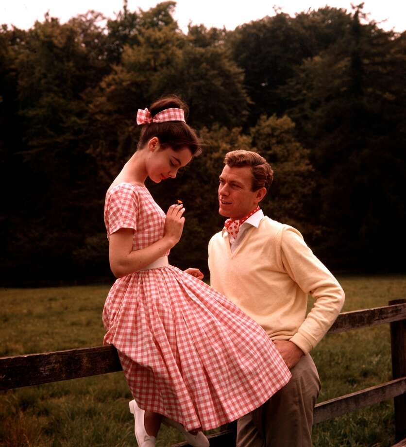 A woman in a pink gingham dress, 1960. Photo: Popperfoto, Popperfoto/Getty Images