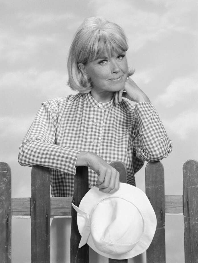 American actress Doris Day holds her hat and leans against a picket fence in a formal portrait as Doris Martin, her character on 'The Doris Day Show,' on June 7, 1968. Photo: CBS Photo Archive, Getty Images