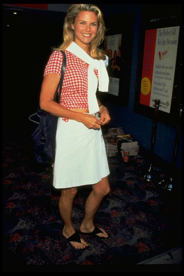 Model Christie Brinkley wearing a red & white checked gingham blouse with white skirt in 1996. Photo: Dave Allocca, Time & Life Pictures/Getty Image