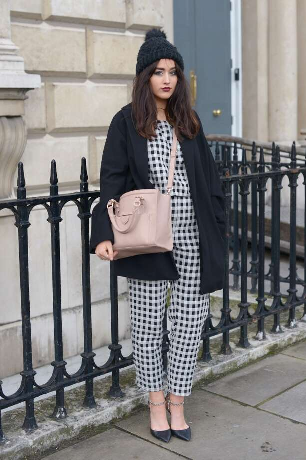 Journalist at British Mode Sophie Milner wears a Topshop hat, trousers and top, Mango jacket, Zara bag, Forever 21 shoes during London Fashion Week on February 15, 2014 in London, England. Photo: Kirstin Sinclair, Getty Images