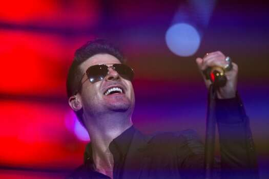 Robin Thicke, March 18    Thicke worked hard during his RodeoHouston show, which drew 61,191 paid attendance. (That's far less than pop acts Usher and Maroon 5 but more than Brad Paisley, Eli Young Band and Reba McEntire.) Photo: Marie D. De Jesús/Houston Chronicle
