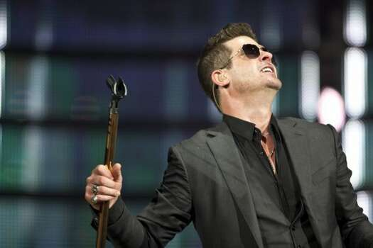 "Robin Thicke, March 18  When Thicke finally launched into ""Blurred Lines,"" the entire venue erupted from its mildly entertained slumber into a full-on dance party. (It was clear that's what most people were waiting for.) Photo: Marie D. De Jesús/Houston Chronicle"