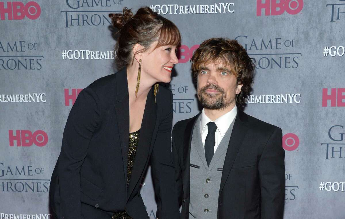 Peter Dinklage, right, and Erica Schmidt arrive at New York Premiere of