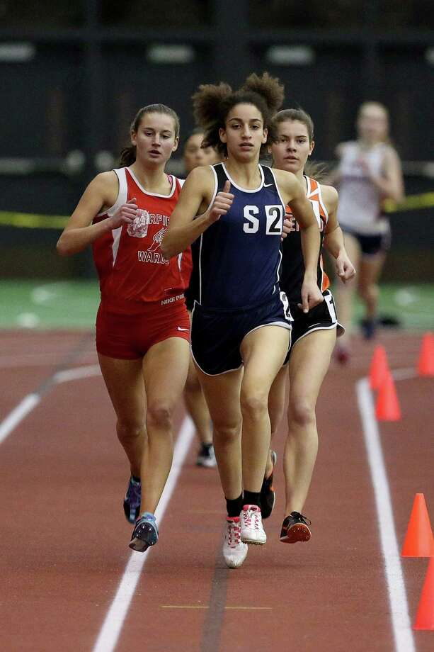 Staples High School's Erica Hefnawy leads the pack during the 1000 meter event during  FCIAC Track Championships held at the Floyd Litttle Athletic Center in New Haven. Photo: Mike Ross / Mike Ross Connecticut Post freelance -www.mikerossphoto.com